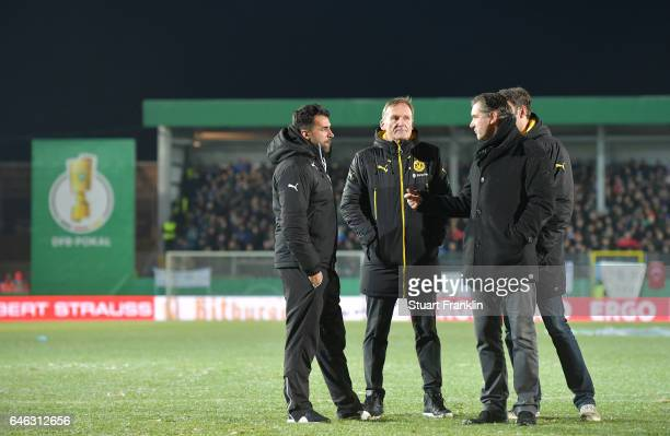 Ismail Atalan head coach of Lotte talks with Hans Joachim Watzke CEO of Dortmund and Michael Zorc Sports director of Dortmund on the pitch as the...