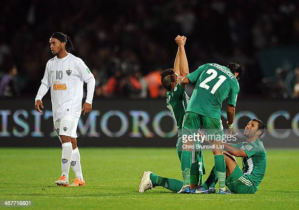 Ismail Benlamalem of Raja Casablanca celebrates with teammate Adil Karrouchy following their side's second goal during the FIFA Club World Cup Semi...