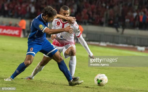 Ismail El Hadad of Wydad Casablanca in action against Mohamed Hany of Al Ahly during the CAF African Champions League match Wydad Casablanca and Al...