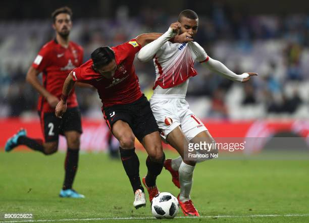 Ismail El Haddad of Wydad Casablanca takes on Tomoaki Makino of Urawa Reds during the FIFA Club World Cup UAE 2017 fifth place playoff match between...