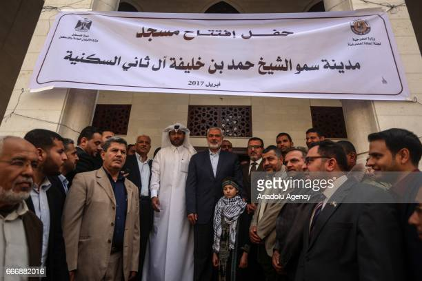 Ismail Haniyeh, the deputy leader of Hamas and Khalid al-Hardan Deputy Head of the reconstruction committee in Gaza are seen during the opening...