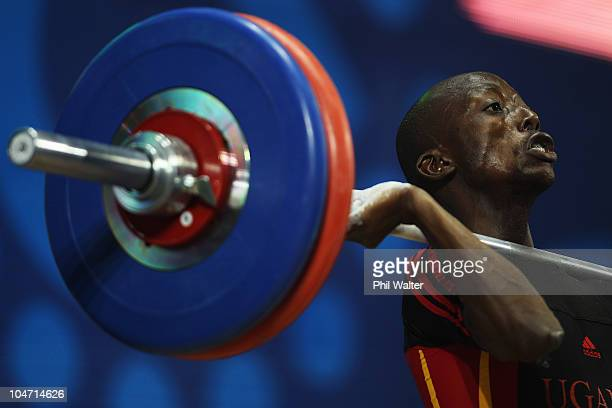 Ismail Katamba of Uganda competes in the Mens 56 kg weightlifting final during day one of the Delhi 2010 Commonwealth Games at Jawaharlal Nehru...