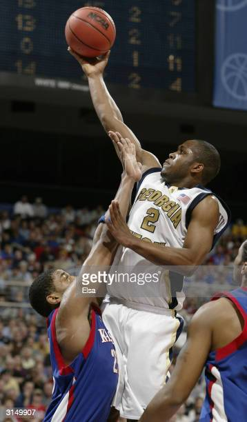 Isma'il Muhammad of Georgia Tech Yellow Jackets goes up for two as Wayne Simien of the Kansas Jayhawks defends during the fourth round game of the...