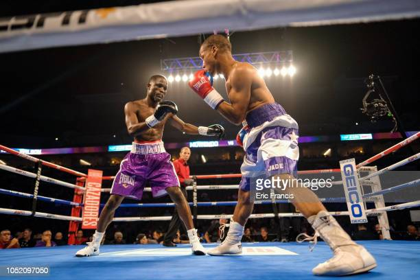 Ismail Muwendo and Andre Wilson exchange blows during their match at at CHI Health Center on October 13 2018 in Omaha Nebraska