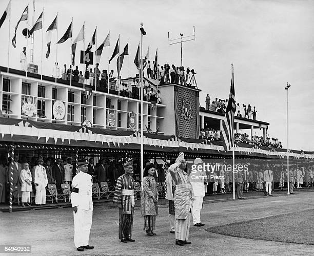 Ismail Nasiruddin Sultan of Terengganu takes the salute at Kuala Lumpur airport on the arrival of Prince Henry Duke of Gloucester and Princess Alice...