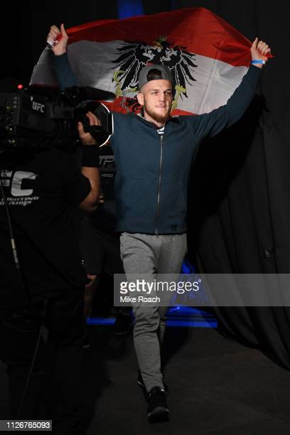 Ismail Naurdiev from Austria poses on the scale during the UFC Fight Night weighin at O2 arena on February 22 2019 in Prague Czech Republic