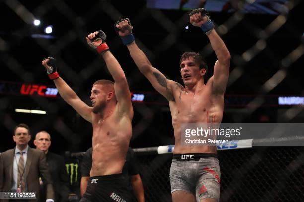 Ismail Naurdiev of Austria and Chance Rencountre celebrate the conlusion of their welterweight fight during the UFC 239 event at TMobile Arena on...