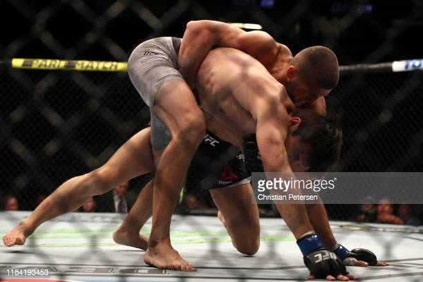 Ismail Naurdiev of Austria and Chance Rencountre grapple in their welterweight fight during the UFC 239 event at TMobile Arena on July 6 2019 in Las...