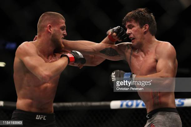 Ismail Naurdiev of Austria and Chance Rencountre trade punches in their welterweight fight during the UFC 239 event at TMobile Arena on July 6 2019...