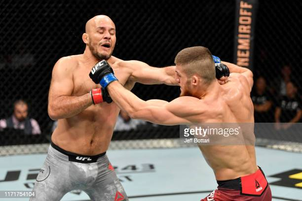 Ismail Naurdiev of Austria and Siyar Bahadurzada of Afghanistan exchange punches in their welterweight bout during the UFC Fight Night event at Royal...