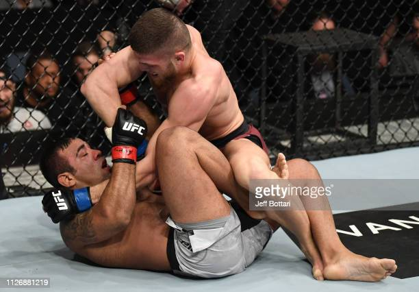Ismail Naurdiev of Austria elbows Michel Prazeres of Brazil in their welterweight bout during the UFC Fight Night event at O2 Arena on February 23...