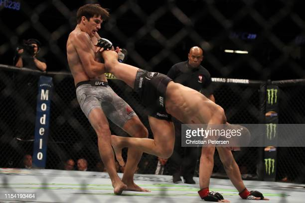 Ismail Naurdiev of Austria kicks Chance Rencountre in their welterweight fight during the UFC 239 event at TMobile Arena on July 6 2019 in Las Vegas...