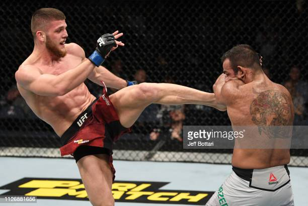 Ismail Naurdiev of Austria kicks Michel Prazeres of Brazil in their welterweight bout during the UFC Fight Night event at O2 Arena on February 23...