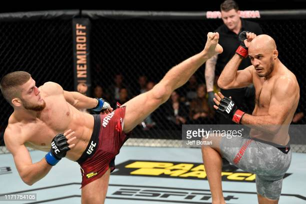 Ismail Naurdiev of Austria kicks Siyar Bahadurzada of Afghanistan in their welterweight bout during the UFC Fight Night event at Royal Arena on...