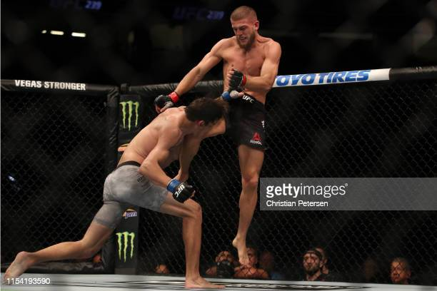 Ismail Naurdiev of Austria knees Chance Rencountre in their welterweight fight during the UFC 239 event at TMobile Arena on July 6 2019 in Las Vegas...