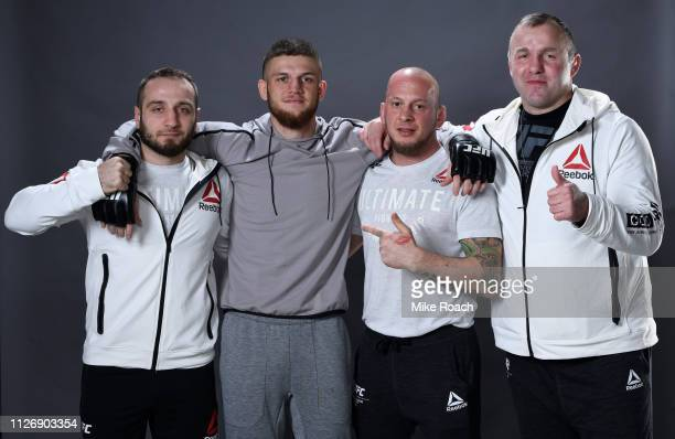 Ismail Naurdiev of Austria poses for a portrait backstage with his team after his victory over Michel Prazeres during the UFC Fight Night event at O2...