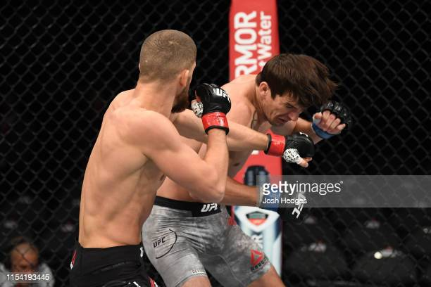 Ismail Naurdiev of Austria punches Chance Rencountre in their welterweight fight during the UFC 239 event at TMobile Arena on July 6 2019 in Las...