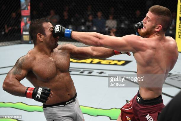 Ismail Naurdiev of Austria punches Michel Prazeres of Brazil in their welterweight bout during the UFC Fight Night event at O2 Arena on February 23...