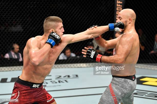 Ismail Naurdiev of Austria punches Siyar Bahadurzada of Afghanistan in their welterweight bout during the UFC Fight Night event at Royal Arena on...