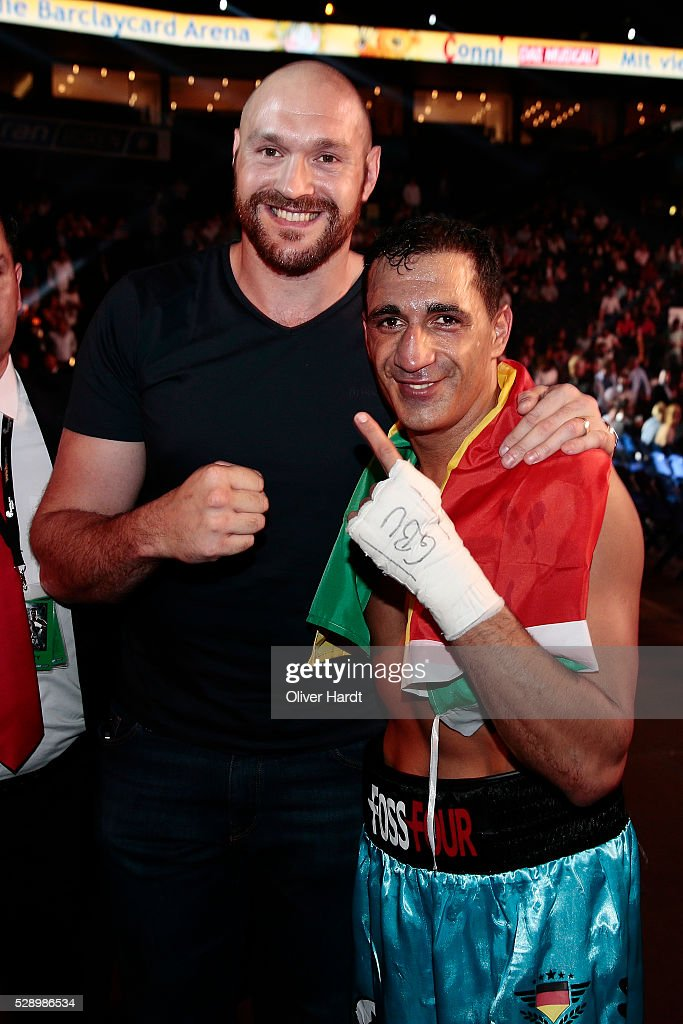 Ismail Oezen of Germany pose with Tyson Fury before the match Kubrat Pulev and Dereck Chisora during Heavyweight European Championship at Barclaycard Arena on May 7, 2016 in Hamburg, Germany.