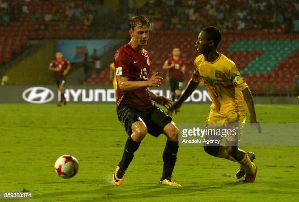 Ismail Çokcalis of Turkey is in action against Djemoussa Traore of Mali during the ceremony within a 2017 FIFA U17 World Cup football match between...