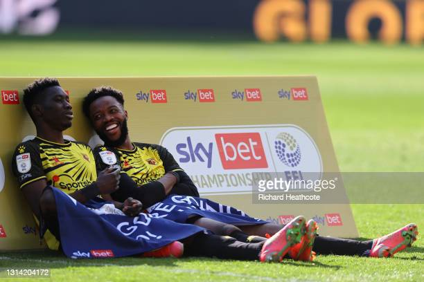 Ismaila Sarr and Nathaniel Chalobah of Watford look on at the final whistle as they are promoted to the Premier League following the Sky Bet...