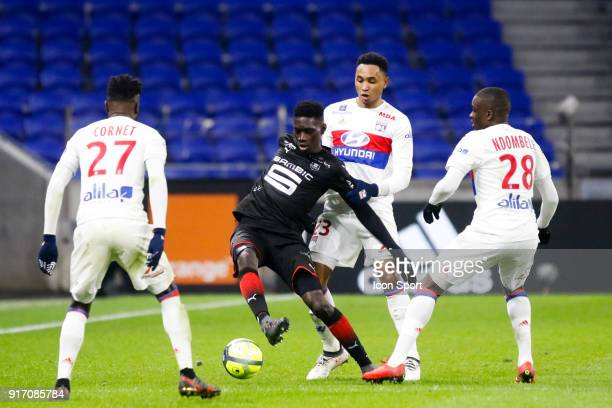 Ismaila Sarr of Rennes and Kenny Tete of Lyon during the Ligue 1 match between Olympique Lyonnais and Stade Rennes at Parc Olympique on February 11...