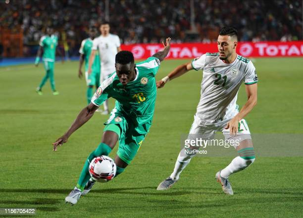 Ismaila Sarr of Senegal and Amir Selmane Rami Bensebaini of Algeria during the Final of 2019 African Cup of Nations match between Algeria and Senegal...