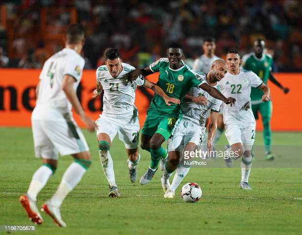 Ismaila Sarr of Senegal and Amir Selmane Rami Bensebaini of Algeria challenging for the ball during the Final of 2019 African Cup of Nations match...