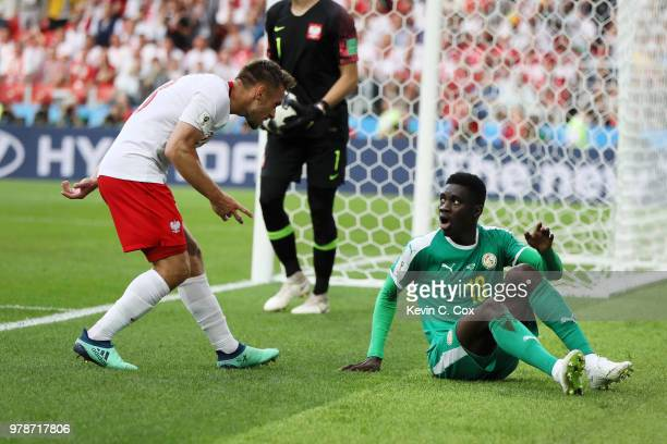 Ismaila Sarr of Senegal argues with Maciej Rybus of Poland during the 2018 FIFA World Cup Russia group H match between Poland and Senegal at Spartak...