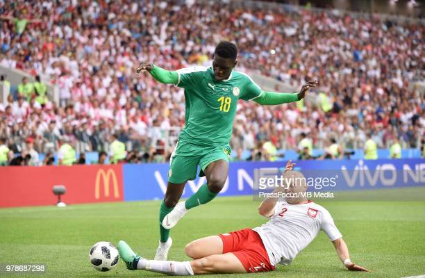 Ismaila Sarr of Senegal competes with Michal Pazdan of Poland during the 2018 FIFA World Cup Russia group H match between Poland and Senegal at...