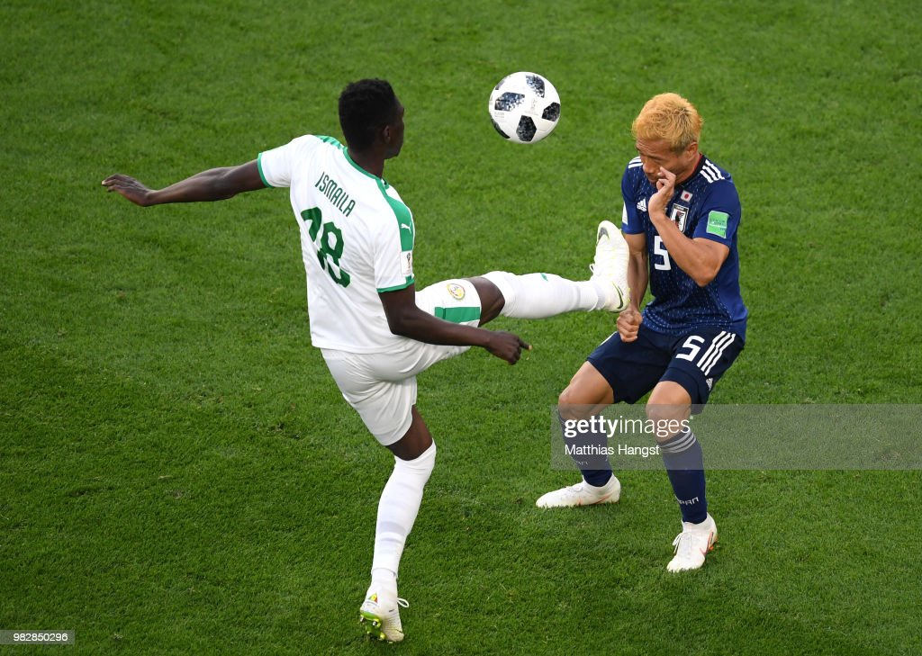 Ismaila Sarr of Senegal tackles Yuto Nagatomo of Japan during the 2018 FIFA World Cup Russia group H match between Japan and Senegal at Ekaterinburg Arena on June 24, 2018 in Yekaterinburg, Russia.