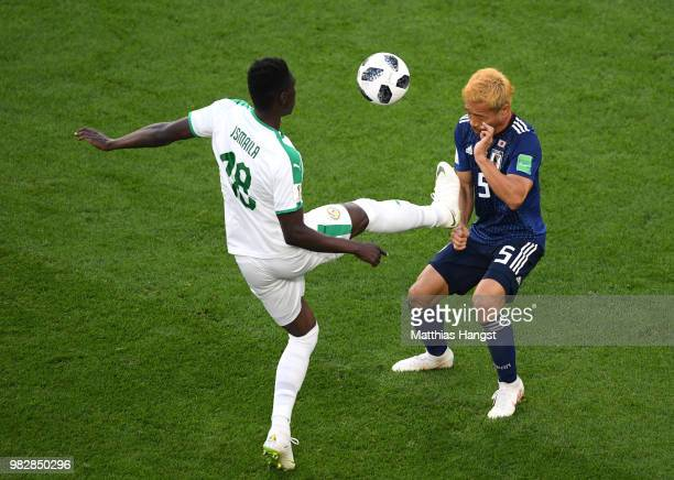Ismaila Sarr of Senegal tackles Yuto Nagatomo of Japan during the 2018 FIFA World Cup Russia group H match between Japan and Senegal at Ekaterinburg...
