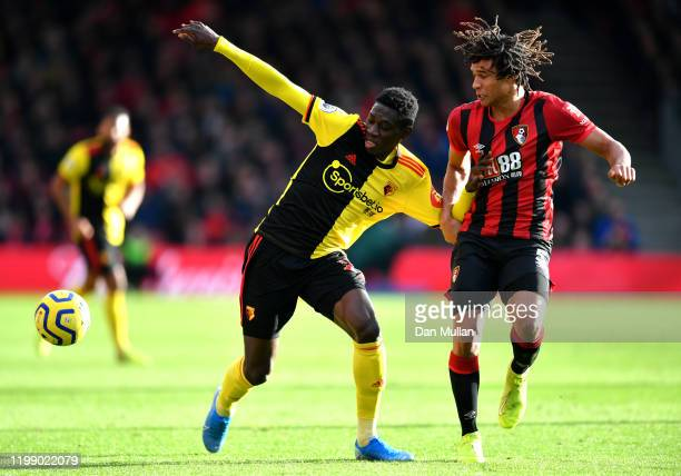 Ismaila Sarr of Watford and Nathan Ake of AFC Bournemouth battle for possession during the Premier League match between AFC Bournemouth and Watford...