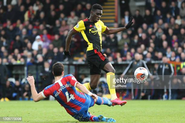 Ismaila Sarr of Watford avoiding the tackle from Luka Milivojevic of Crystal Palace during the Premier League match between Crystal Palace and...