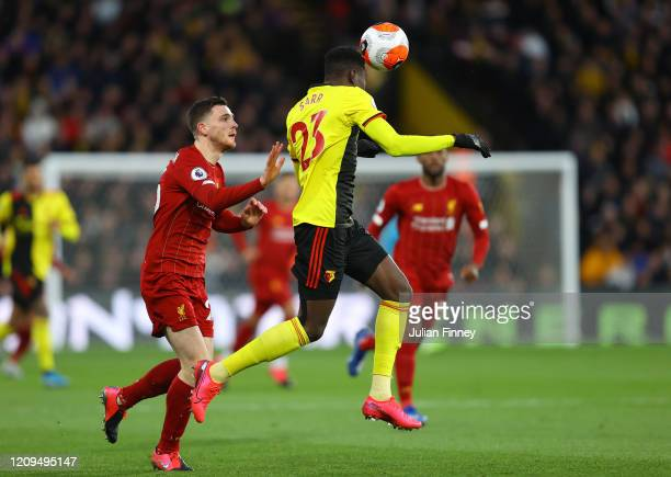 Ismaila Sarr of Watford battles for possession with Andy Robertson of Liverpool during the Premier League match between Watford FC and Liverpool FC...