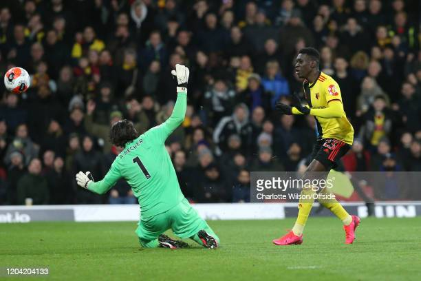 Ismaila Sarr of Watford beats Liverpool goalkeeper Alisson Becker to score their 2nd goal during the Premier League match between Watford FC and...