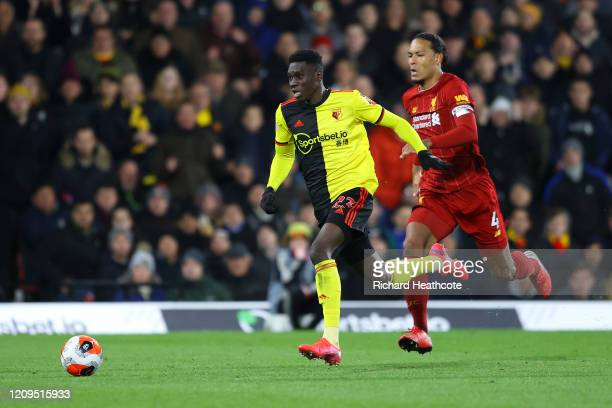 Ismaila Sarr of Watford breaks past Virgil van Dijk of Liverpool to score his team's second goal during the Premier League match between Watford FC...