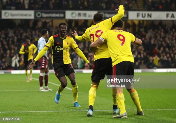 Ismaila Sarr of Watford celebrates after scoring his sides third goal with teammates during the Premier League match between Watford FC and Aston...