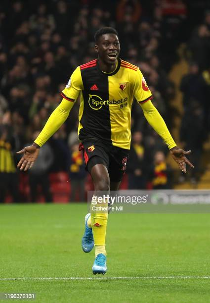 Ismaila Sarr of Watford celebrates after scoring his sides third goal during the Premier League match between Watford FC and Aston Villa at Vicarage...
