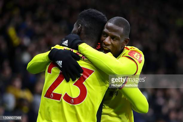 Ismaila Sarr of Watford celebrates after scoring his team's first goal with teammate Abdoulaye Doucoure during the Premier League match between...
