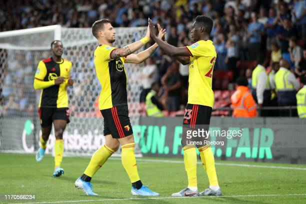 Ismaila Sarr of Watford celebrates scoring his side's first goal with team mate Daryl Janmaat during the Carabao Cup Second Round match between...