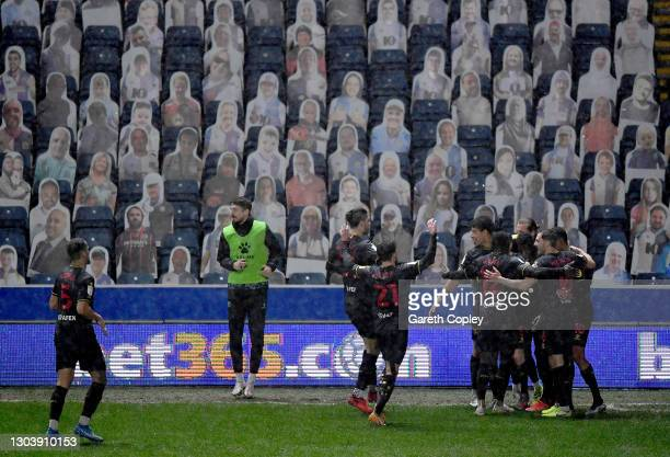 Ismaila Sarr of Watford celebrates with team mates after scoring their team's second goal during the Sky Bet Championship match between Blackburn...
