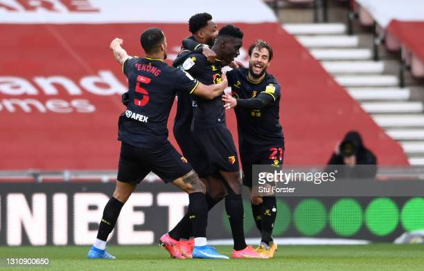 Ismaila Sarr of Watford celebrates with team mates William Troost-Ekong, Kiko Femenia and Nathaniel Chalobah after scoring their side's first goal...