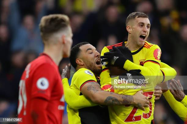 Ismaila Sarr of Watford celebrates with teammates after scoring his team's first goal during the Premier League match between Watford FC and...
