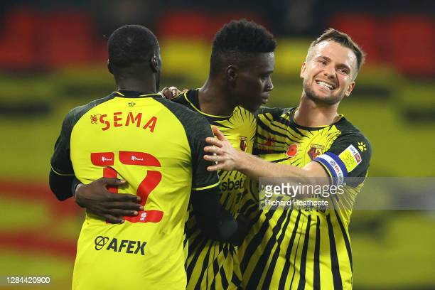 Ismaila Sarr of Watford celebrates with teammates Ken Sema and Tom Cleverley after scoring his team's third goal during the Sky Bet Championship...