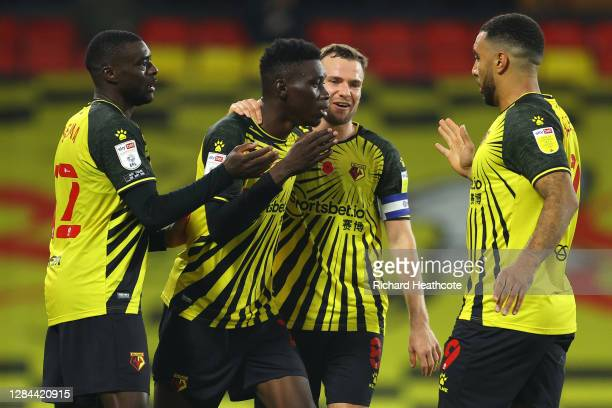 Ismaila Sarr of Watford celebrates with teammates Ken Sema, Tom Cleverley and Troy Deeney after scoring his team's third goal during the Sky Bet...