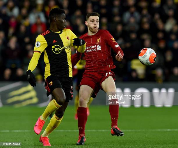 Ismaila Sarr of Watford competing with Andy Robertson of Liverpool during the Premier League match between Watford FC and Liverpool FC at Vicarage...