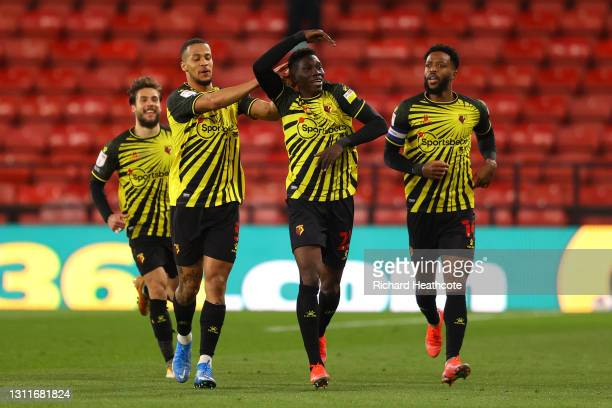 Ismaila Sarr of Watford FC celebrates with teammates William Troost-Ekong and Nathaniel Chalobah after scoring their team's first goal during the Sky...