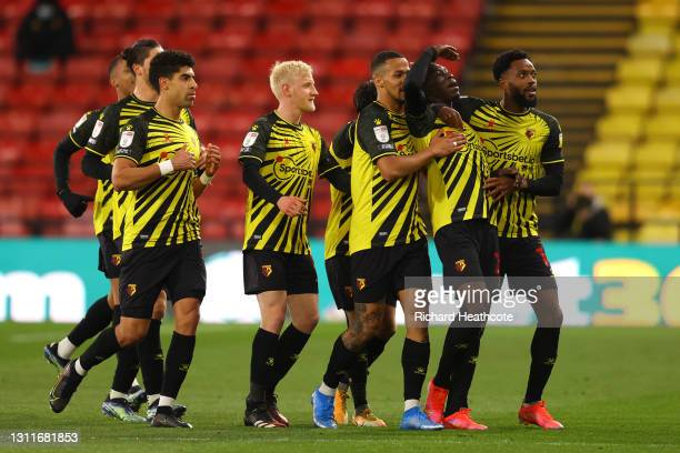 Ismaila Sarr of Watford FC celebrates with William Troost-Ekong, Nathaniel Chalobah and teammates after scoring their team's first goal during the...